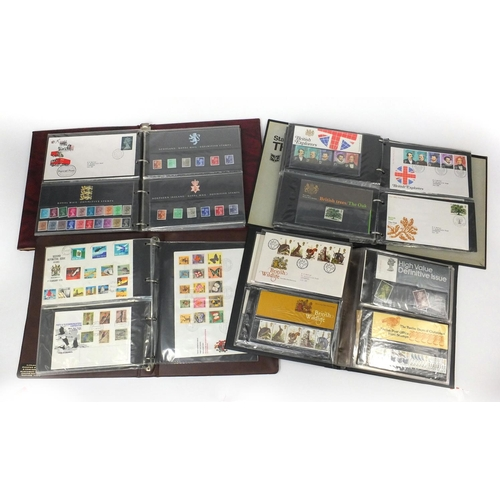 2788 - Four albums of GB presentation packs and first day covers including British Theatre, Two Pay Labels,...