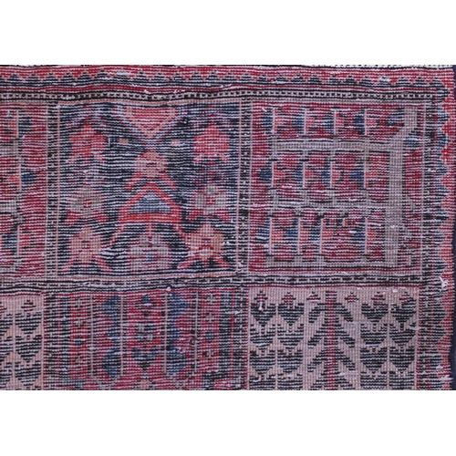 2035 - Rectangular Bakhtiari rug with an all over panelled design onto a red ground, 242cm x 156cm