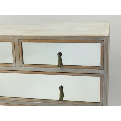 2005 - Bleached pine chest fitted with two short above three graduated long drawers with mirrored fronts an...