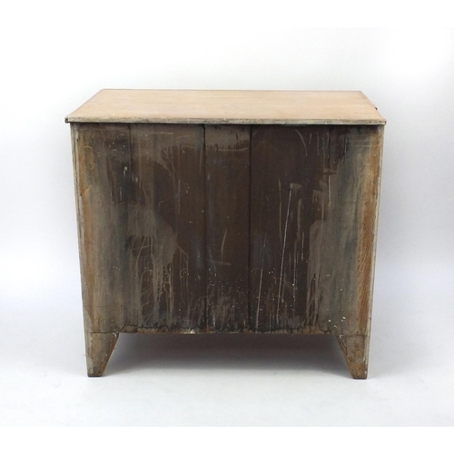 2024 - Bleached wooden four drawer chest with oval brass handles embossed with a classical reclining lady, ...