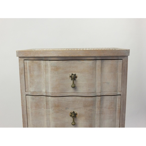 2017 - Bleached wooden four drawer chest with mirrored top and brass drop handles, 106cm high x 58cm wide x...