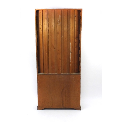 2051 - Bleached wooden and painted cabinet with open shelves above a pair of panelled doors, 209cm high x 9...