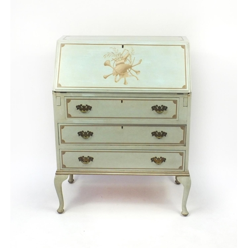2057 - Green painted bureau, the fall decorated with musical instruments above three drawers, 100cm high x ...