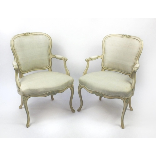 2038 - Pair of cream and green painted French fauteuil chairs with upholstered stuffover seats and back pan...