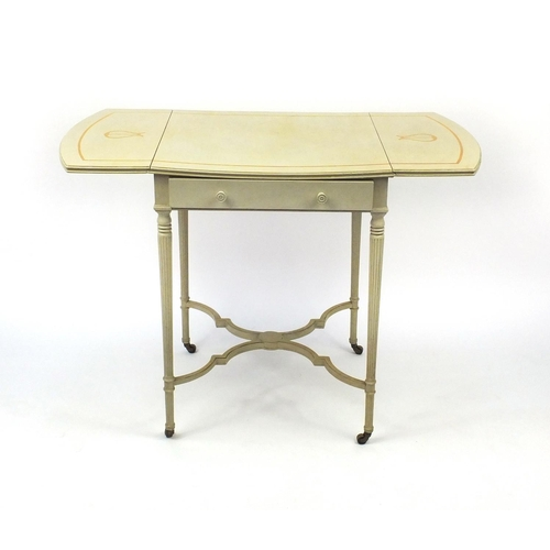 2040 - Cream and gilt painted Pembroke table on reeded legs with shaped stretcher, 72cm high