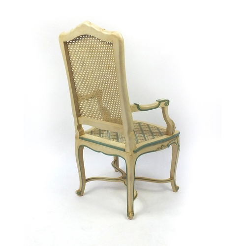 2015 - Set of six cream and green painted highback dining chairs with cane panelled backs and seats to incl...