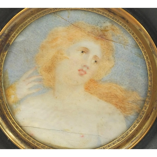 14A - Three watercolour portrait miniatures, including one onto ivory of a semi nude female with flowing h...