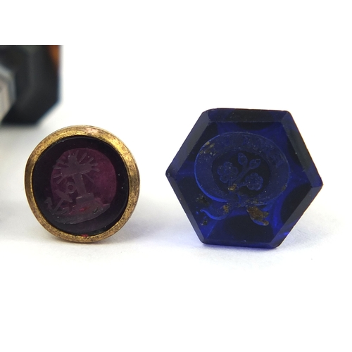 117 - Four Victorian intaglio desk seals including two agate handled examples, the largest 3.2cm long