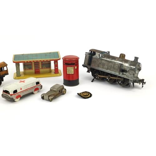 419 - Group of tinplate and clockwork toys including an orange Schuco locomotive, blue locomotive marked '...