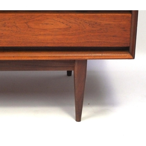 2007 - Vintage Heals teak sideboard designed by Richard Hornby, fitted with four drawers and a pair of cupb...