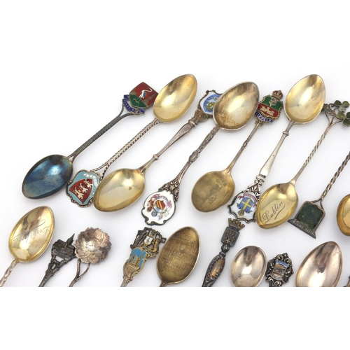 956 - Large selection of silver souvenir silver teaspoons some with enamelled terminals, including Cornwal...