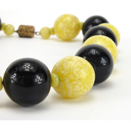 1063 - Splatted glass bead necklace, 40cm in length, approximate weight 226.8g...