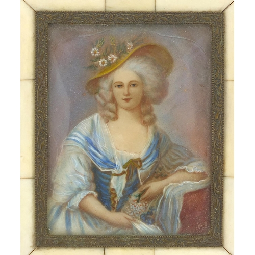 7 - Rectangular hand painted portrait miniature of a seated female wearing a wide brimmed hat, housed in...