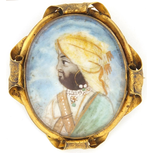 5 - Oval hand painted portrait miniature of an Indian gentleman wearing a hat, housed in a gilt metal br...