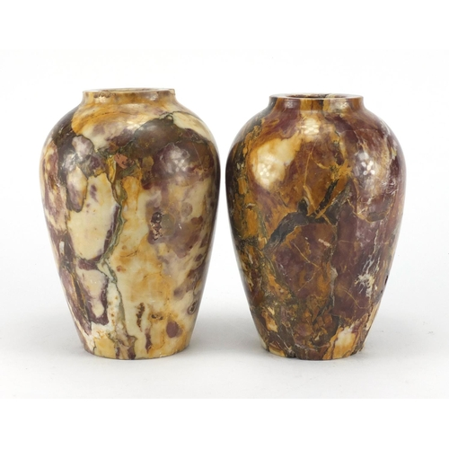 37 - Pair of Victorian variegated marble vases, each 21cm high...