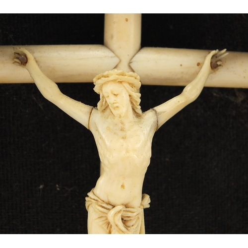 43 - 19th century carved ivory Corpus Christi on cross housed in a case, overall 23cm high...