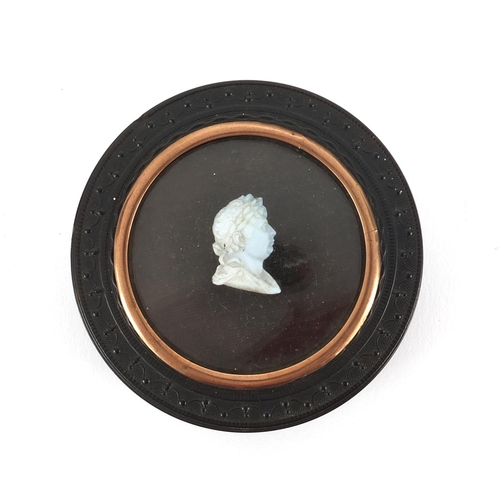 17 - Georgian tortoiseshell snuff box inset with a cameo of  George III, 7cms round...