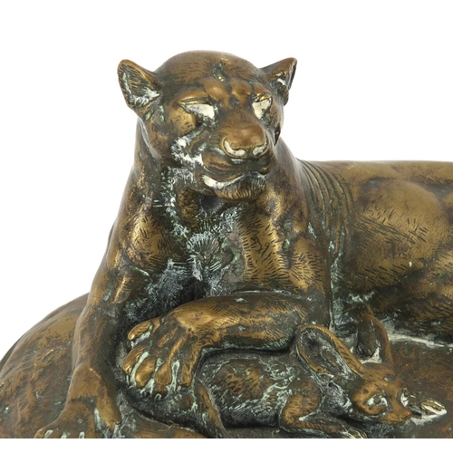 24 - Paul-Edouard Delabrierre 1829-1912, patinated bronze recumbent Puma with a Fennec fox on oval base, ...