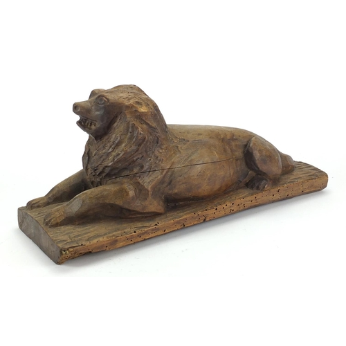 47 - Antique continental wood carving of a recumbent lion, 46cm wide...