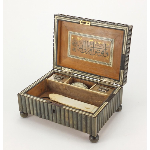 639 - Ottoman horn and ivory inlaid calligraphy box, housing tools and two silver inkwells, the tools incl...