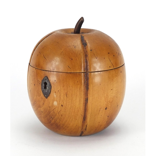 48 - Fruitwood tea caddy of apple form with metal escutcheon and remnants of lining to the interior, 13cm...
