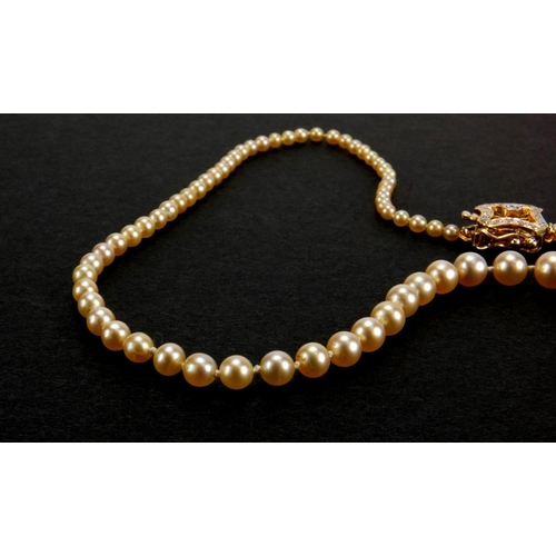 958 - Single string natural pearl necklace with 18ct gold diamond clasp, 46cm in length, approximate weigh...