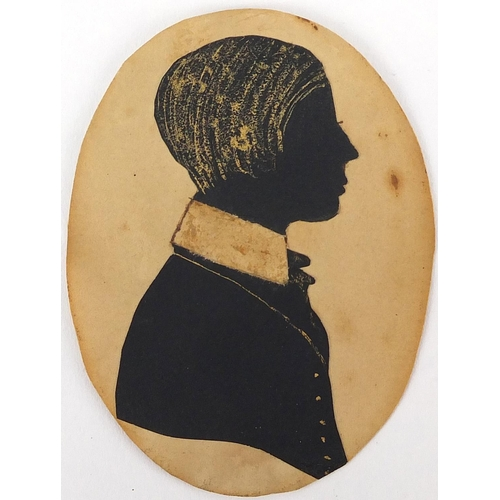 14 - Pair of 19th century silhouettes, one of a male one of a female, both housed in black ebonised frame...