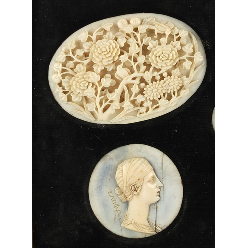 16 - Six carved ivory portrait panels together with a pair of Chinese Canton panels carved with flowers a...