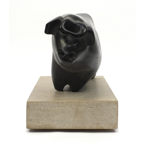 33 - Caroline Byng Lucas 1886-1967, Bull, large ebony sculpture on rectangular stone plinth, exhibited in...