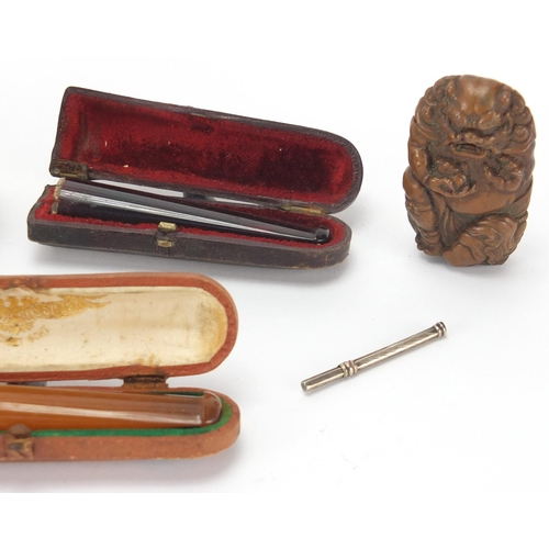 33 - Antique and later objects including two amber coloured cheroots with fitted leather cases, four vest...