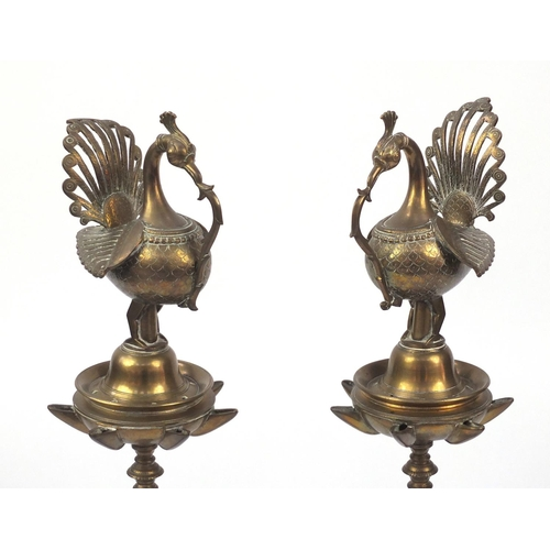 587 - Pair of Middle Eastern floor standing brass oil burners, each 95cm high...