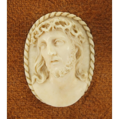 11 - 19th century carved ivory cameo of Christ, housed in a carved gilt wood frame, overall 31.5cm x 17cm...