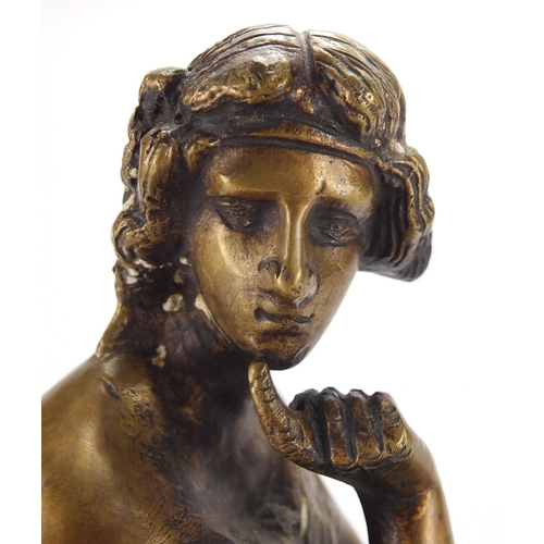 49 - Patinated bronze study of a seated female seated in classical dress, on shaped base, 29cm high...