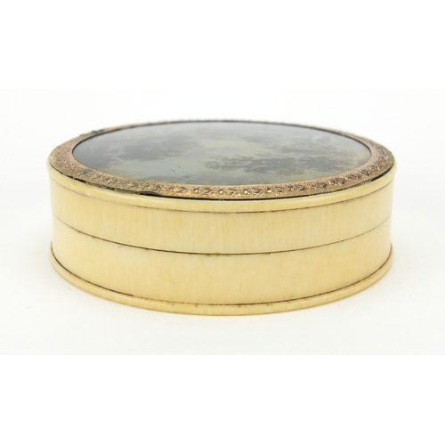 16 - 18th century circular ivory snuff box with gilt mount and red tortoiseshell lining, the lid hand pai...