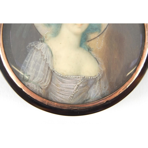 17 - 18th century circular tortoiseshell portrait snuff box with gold coloured mount, the lid hand painte...
