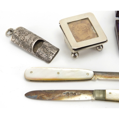 40 - Silver objects and two thimbles, one housed in a velvet lined leather case comprising chatelaine whi...