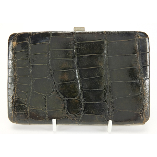 23 - 930 silver mounted crocodile skin effect purse and a pair of gilt metal folding lorgnettes with purp...