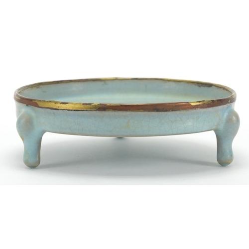 627 - Chinese porcelain blue glazed tripod censer with partially gilt copper rim, 4.5cm high x 14cm in dia...