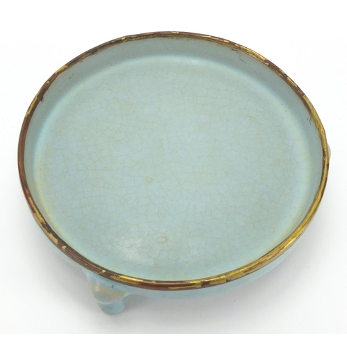 627 - Chinese porcelain blue glazed tripod censer with partially gilt copper rim, 4.5cm high x 14cm in dia...