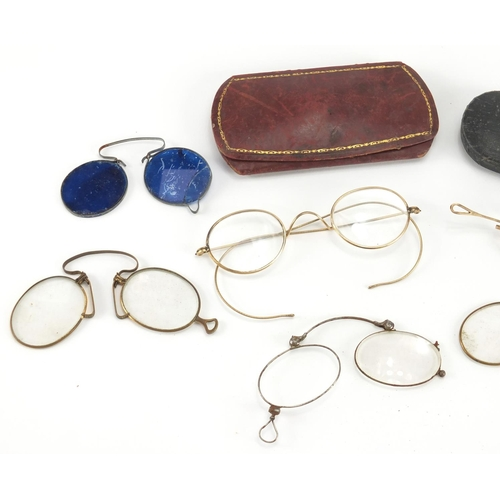 46 - Victorian and later spectacles including four with gold coloured metal mounts...