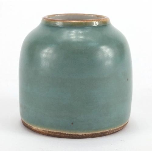 626 - Chinese porcelain green glazed brush washer, blue ring marks to the base, 5.7cm high...