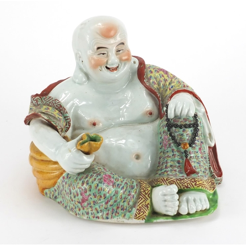 570 - Chinese porcelain figure of Buddha holding a sack, finely hand painted in the famille rose palette, ...