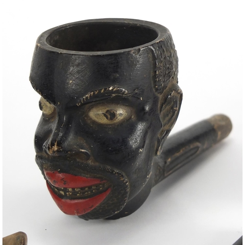 48 - Five antique and later pipes including including a Blackamoors head and Meerschaum example with maid...