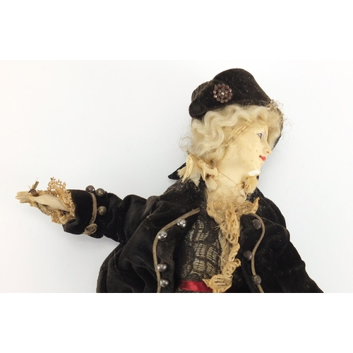 494 - Early 20th century French hand painted plaster doll wearing traditional dress, approximately 28cm in...