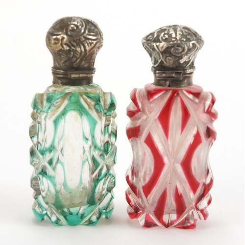 8 - Two Victorian flashed cut glass scent bottles with unmarked silver mounts, one with stopper, the lar...