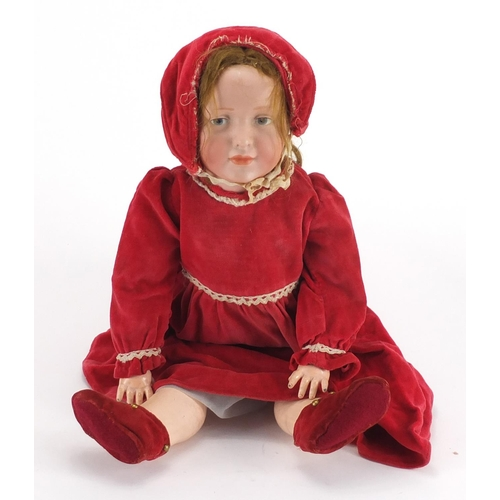 495 - 19th century German bisque headed doll, with jointed limbs in traditional dress, impressed KR 109 to...