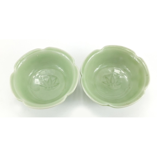 628 - Pair of Chinese celadon glazed porcelain lotus bowls, each 15.5cm in diameter...