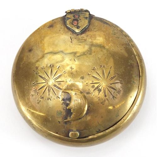 20 - Late 18th century circular brass secret snuff box, 8.5cm in diameter...