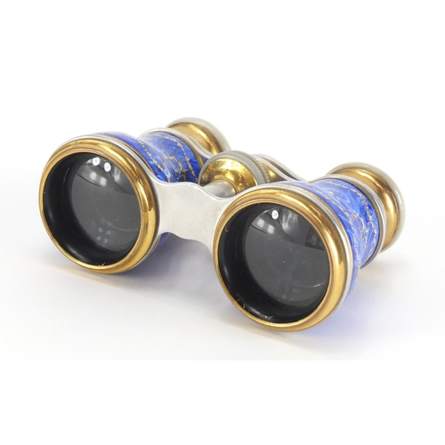 23 - Pair of brass and Mother of Pearl opera glasses, the guilloche enamelled jewelled barrels decorated ...