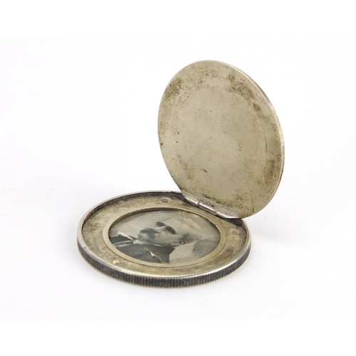 45 - Novelty 19th century trade dollar secret coin locket, 4cm in diameter, approximate weight 21.8g...